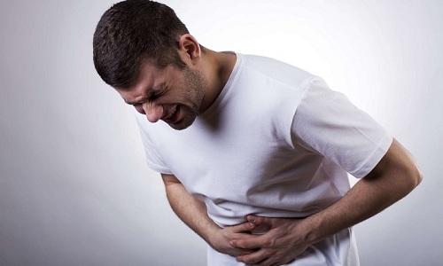 Реже после приема препарата появляется боль в области живота